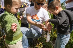 Cameron Cruscial and students from the Redeemer preschool release ladybugs into the Redeemer Community Garden.