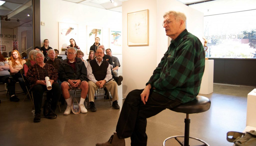 Rick Bartow shares stories and explains his process of creating to an attentive audience.
