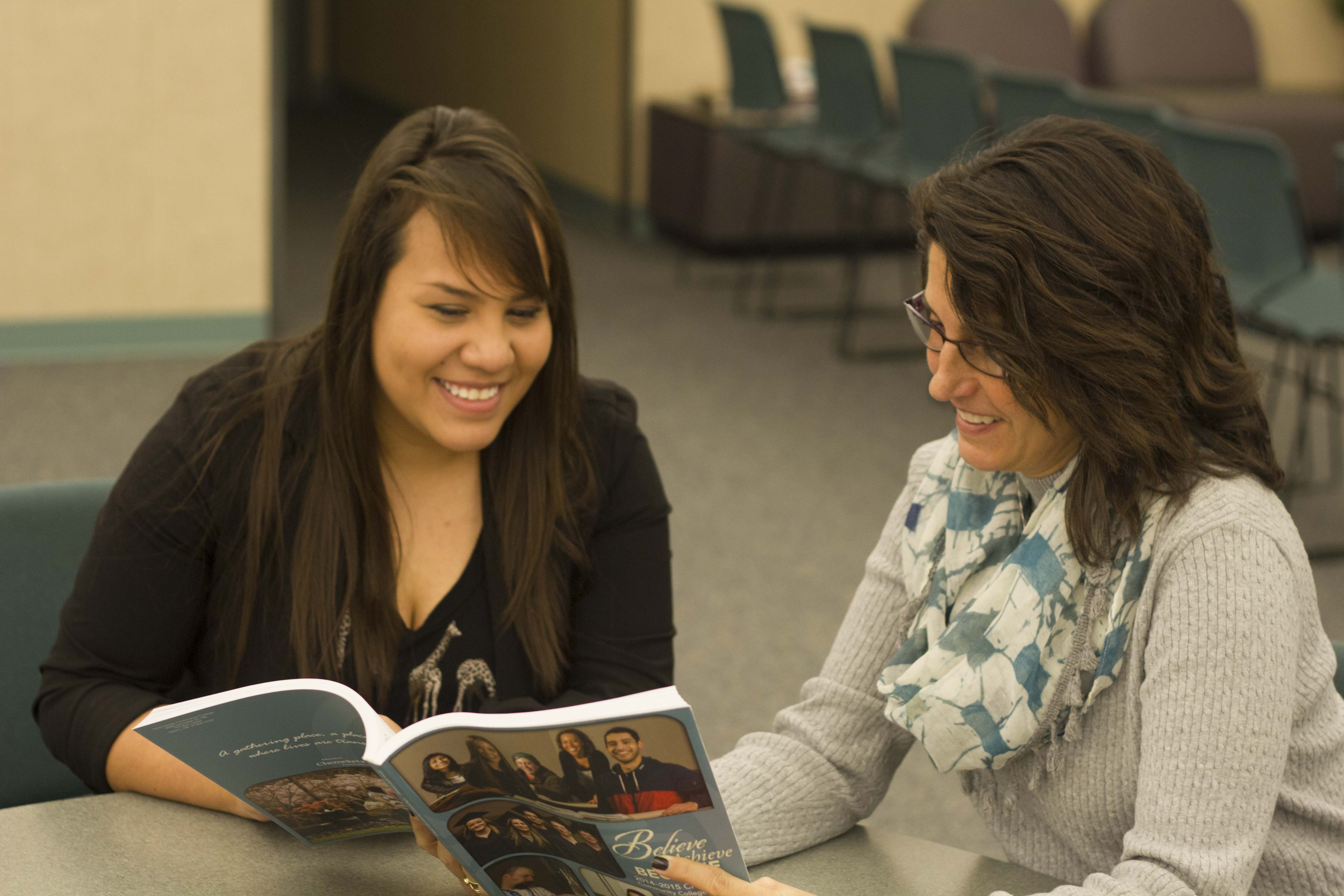 Ceeilia Sanchez (left), a second-year student, discusses the possibility of transferring to Portland State University with Tiffany Borden, an academic adviser for Chemeketa.
