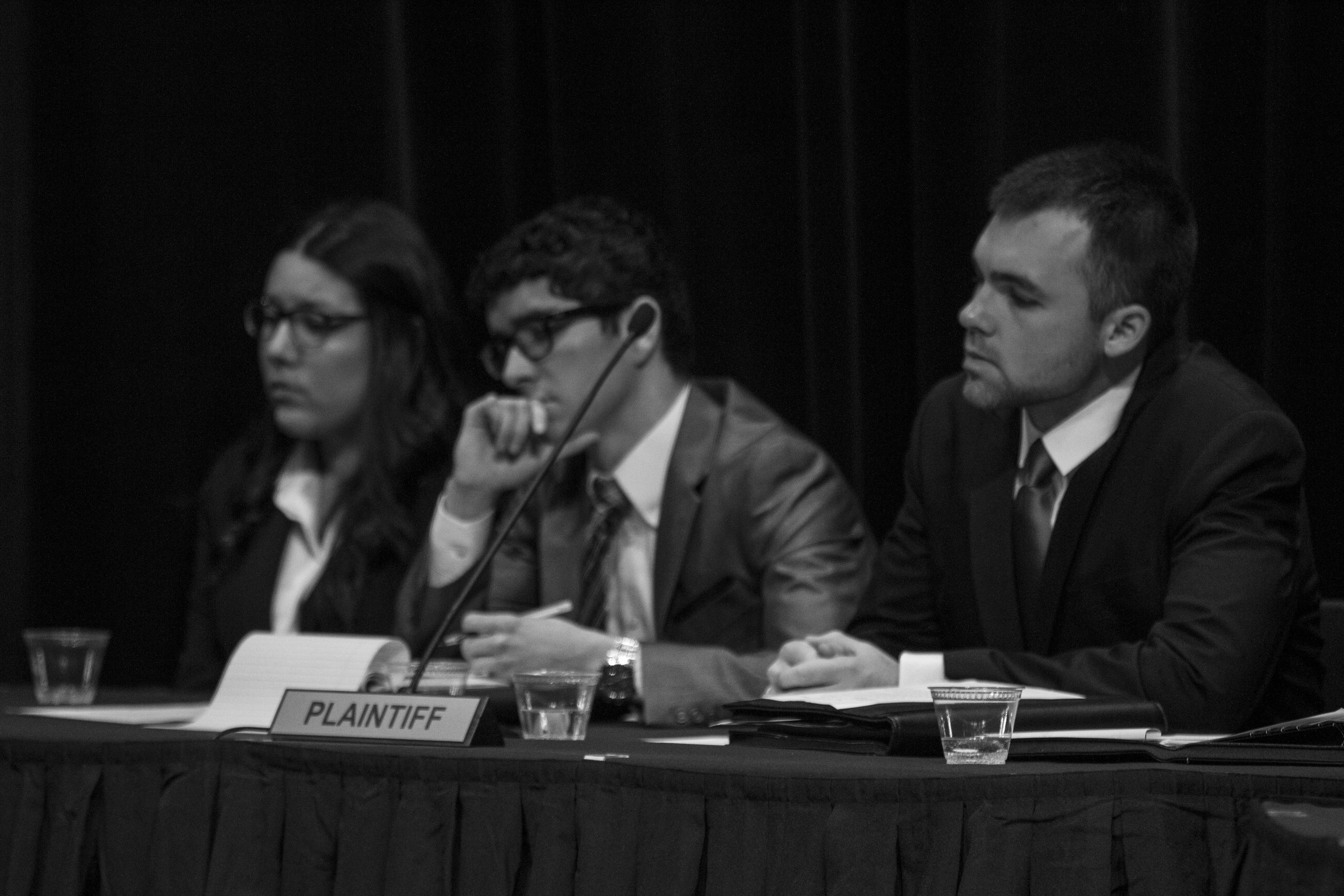 From left, plaintiff attorneys Delia Rivera, Mj Flores, and Connor Amundson listen intently to the defense's arguments in a recent Mock Trial presentation at Chemeketa.