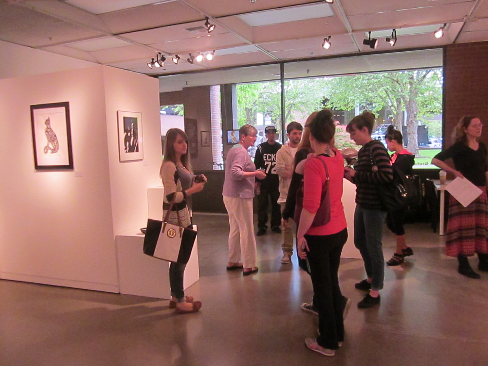 Gallery patrons mingle during the Student Art Show opening on May 13.