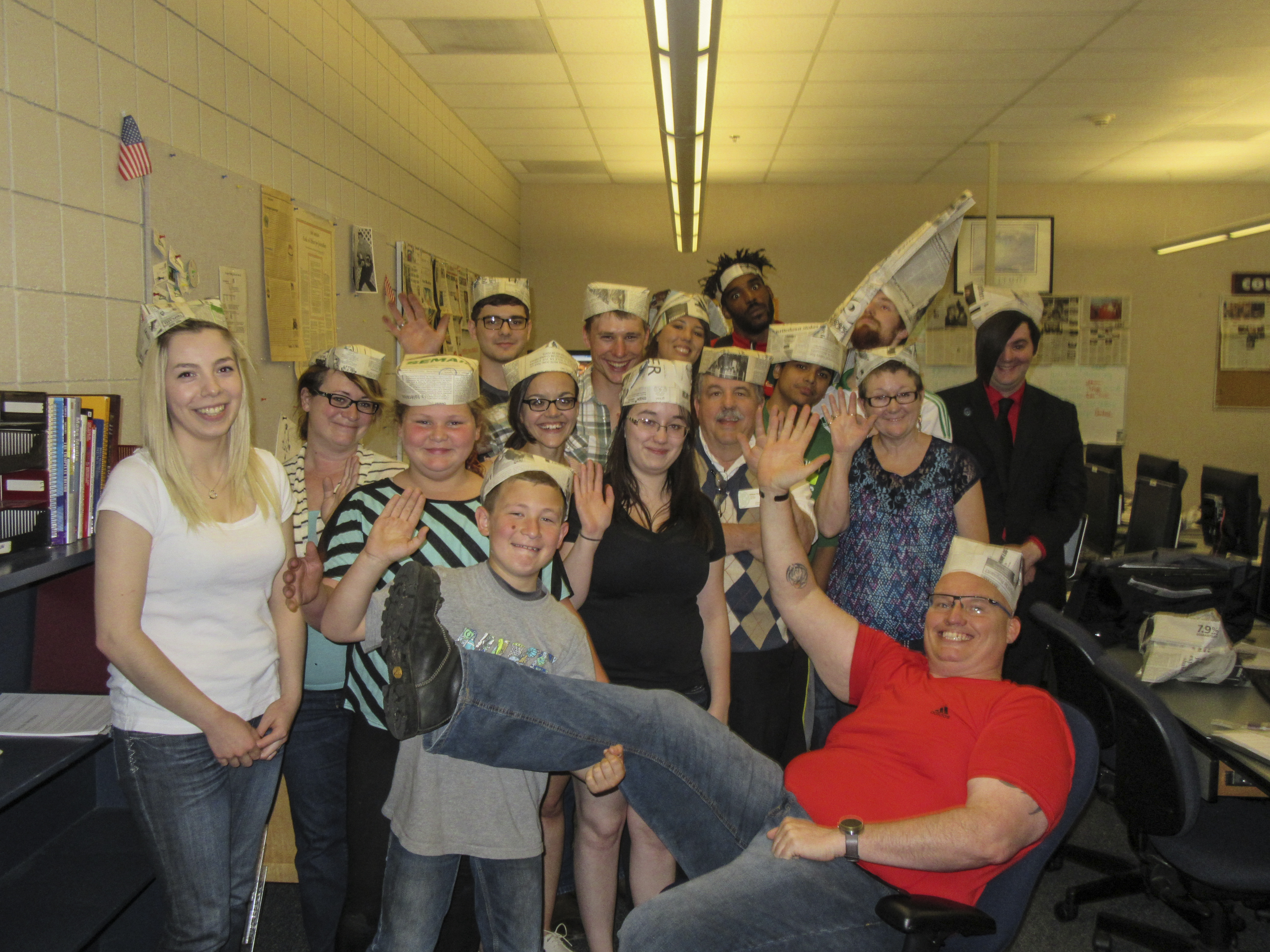 Members of the Courier staff and their offspring wave goodbye after producing the final edition.