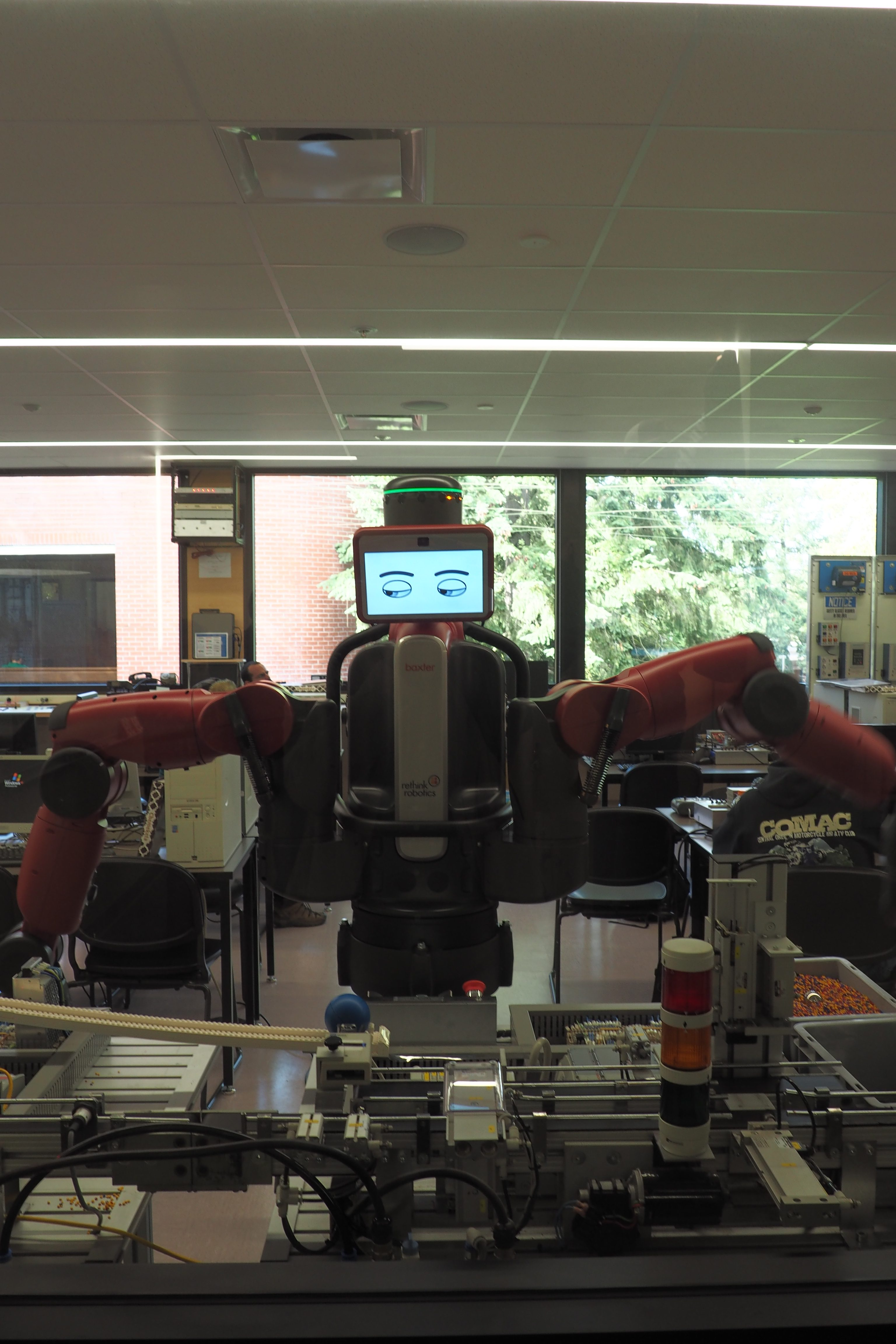 The robot, affectionately known as Baxter, as seen from the hallway outside the robotics lab. Photo by Saul Rodriguez